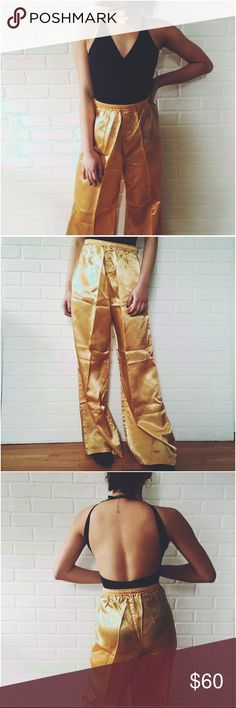 🆕 High Waisted Golden Aladdin Pants High Waisted Golden Aladdin Pants. Stop everything now and admire these gorgeous pants! Feel like a goddess in these paired with a deep v body suit! Would best fit a waist 25 to a 28 cuz of its Elastic waist! #widelegpants #highwaisted #trousers no brand! Urban Outfitters Pants