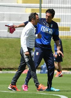 Head coach Italy Cesare Prandelli (L) and Gianluigi Buffon during training session on June 22, 2014 in Natal, Brazil.