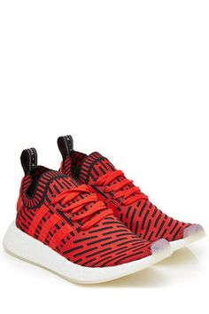 various colors 0fdd0 4ecc0 ... these futuristic NMD sneakers from Adidas boast urban credibility,  round-the-clock comfort and a cool attitude in bold combination of red and  black.