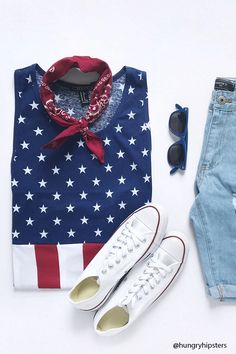 Show your patriotic side with this knit tank top featuring an allover American Flag motif and a scoop neckline.