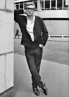 Q. How do you make a dodgy cardigan look good? A. Give it to Michael Caine (in London, c. mid-1960s)