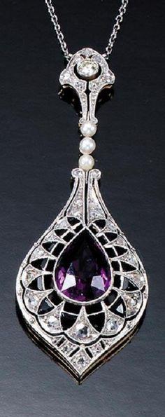 An Edwardian amethyst, onyx and diamond pendant, circa 1910.