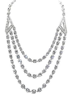 Festoon Necklace. In 1947 King George VI commissioned a three strand diamond necklace containing over 150 brilliant cut diamonds to get rid of some the loose diamonds he had inherited.  The necklace consists of three small rows of diamonds with a triangle motif. Our stunning Festoon Necklace is inspired by this beautiful piece of jewellery in the Queen's private collection. http://www.royalyachtbritannia.co.uk/shop/royal-jewellery-collection/festoon-necklace/c-24/c-76/p-918