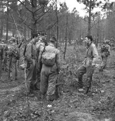from l-r: Warren Roush, Lewis Nixon (with the cigarette), Dick Winters (with his back to the camera) and Herbert Sobel during training exercises, 1943