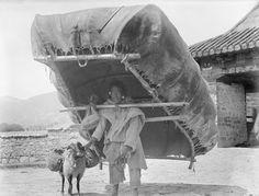 Man carrying hide boat by Yuthok bridge Thibet