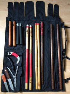 Filipino martial arts wrap around case with my training sticks,knifes,sword,nunchakus and palm stick