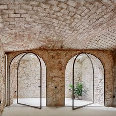 INTERIORS: Rustic brickwork contrasted beautifully with arched pivot doors in this Barcelona triplex by Valentí Albareda Detail Architecture, Minimalist Architecture, Contemporary Architecture, Art And Architecture, Architecture Interiors, Contemporary Interior, Interior Barn Doors, Interior And Exterior, Interior Design