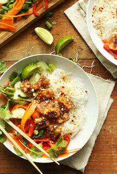 30-minute Thai noodle bowls with rice noodles, fresh veggies, and crispy almond butter tofu! A flavorful, healthy, satisfying plant-based meal.