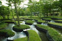 Beautifully terraced, grass, water, trees. I wish this could be my yard...