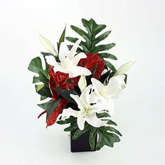 Image from http://www.flowers24hours.co.uk/flowers/images/images4/red-white-lily-anthurium-silk-flower-arrangement-350.jpg.