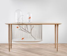 Archibird Cage Table: Bird Cage Built Into A Table - not that I condone keeping birds or any animal in cages this is pretty cool.