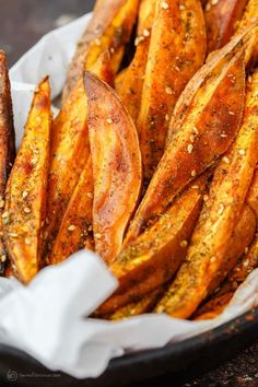 Easy baked sweet potato fries made the Mediterranean way. Tossed in olive oil and covered in za'atar spice, paprika, cayenne. The best! Vegan. Gluten Free.