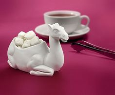 Help yourself to one lump or two from this camel sugar bowl! You can sit it down on the table at breakfast or after dinner so you can serve your guests some sugar lumps with their coffee.