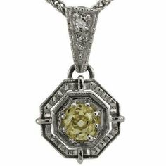 "Platinum Antique Canary Diamond Pendant Da'Carli. $1725.00. Call 1(888) 527-9422 for a different combination of gemstones, 18k, Yellow Gold, or Platinum. When calling, please, provide the model number: 13514ALT03. Free Standard Shipping with this item!. Free Pendant Box included with this item!. 5.80 grams total pendant weight in solid platinum. The pendant also comes with a 16"" long chain made in solid platinum.. This Pendant is set with 4 diamonds weighing 0...."