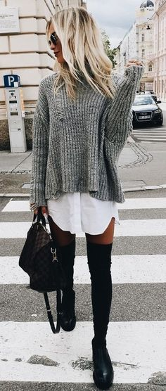 Gray sweater over white tunic with black OTK boots.