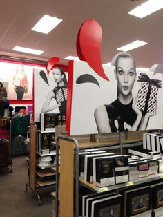 Target featured Neiman Marcus fixture signage. This signage creates a fun and elegance that is consistent with Neiman Marcus brand, and that also blends well within Targets environment.