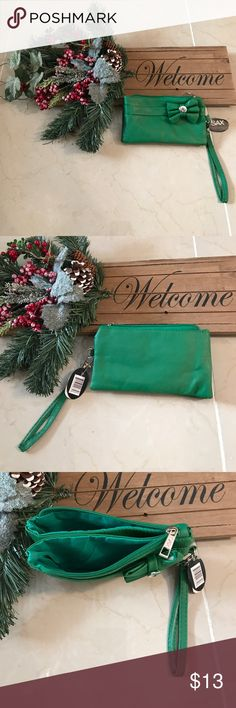 Cute new sax wristlet wallet purse green This is a cute new Sax wallet wristlet purse with 3 different compartments in a bright green color! What a cute gift or stocking stuffer! Bags Wallets
