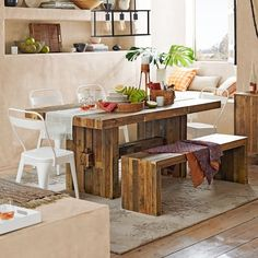 """Emmerson 62"""" Dining Table, Reclaimed Pine, $899, West Elm. Gabrielle recommends buying items that already have patina, like a reclaimed wood table, or a table made of barnwood. Then you won't mind any additional scratches or marks your kids add."""