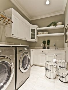 Great inspiration for a laundry room.. amazing organization, love the counter on top of the washer and dry, and I love how bright this spaces is even with no windows!