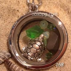 Turtle Seaside Memory Locket necklace with green glass and Swarovski crystals.  http://bluepelicangallery.com/product/seaside-memory-lockets/