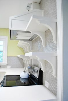 What a great diy and cover up - range hood. Love the shelves also. Thanks Young House Love for the tutorial.  http://www.younghouselove.com/2012/02/i-gotcha-covered/