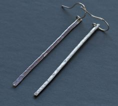 Long Sterling Silver earrings. Handmade by me in my home studio. These earrings are easy to wear and will add just enough sparkle to any outfit. They have a hammered finish, and feature a very slight taper at the top. Measurements: 2 3/8 inches long x 1/8 inch wide.