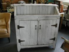 Primitive Dry Sink made from a shed door, salvaged wainscott, hardware and cratewood