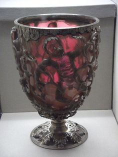 The celebrated Lycurgus cup, one of the finest examples of Roman glassware made in the 4th century CE. The cup is an example of the diatreta or cage-cup type where the glass was cut away to create figures in high relief attached to the inner surface with small hidden bridges behind the figures. The cup is so named as it depicts the myth of Lycurgus entwined in a vine. (British Museum, London).