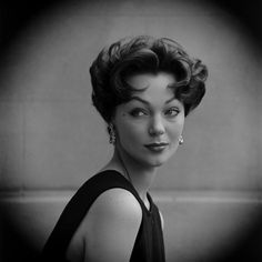 Italian Cut - shaggy but sculptured with deep waves on the crown - spit curls frame the forehead and cheeks and a carefully ragged nape - 1953