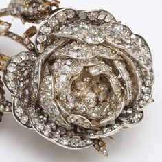 Victorian Diamond Rose Brooch. Diamond brooch in the form of a rose, set in gold and silver.English, ca. 1860
