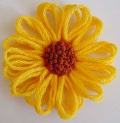 Cute flower--could be used for hairbows--use cool yarn though!