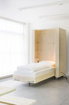 High Flexibility For Modern People: Atelierhouse: Impressive Creation For Folding Bed Design With White Design And Nice Small Shelving Also ...