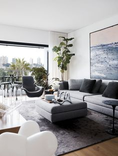 A large doorway opening onto a private terrace lets an abundance of natural light fall into the living room of this renovated Sydney apartment. Photography: David Wheeler - May 04 2019 at Living Room Plan, Living Room Furniture Layout, Living Room Seating, Living Room Interior, Living Room Designs, Living Room Decor, Sala Grande, Grey Room, Beautiful Living Rooms