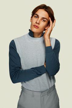 Frederik wears polo H&M, sweater vest COS, and pants Libertine-Libertine.