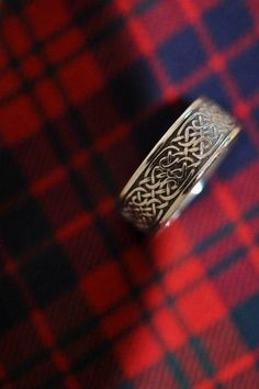 We love the masculine look of this handmade celtic wedding band. #wedding #ring