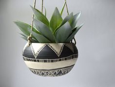 This hanging planter is wheel thrown and hand carved. This listing is ready to ship. Measures 7X4 inches and does not include a drain hole. Planter comes