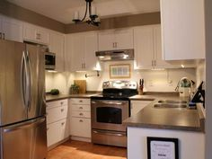 Small Kitchen Makeover Turtles and Tails: Kitchen Makeover Reveal Looks like same countertop we have. White Kitchen Cupboards, Kitchen Cabinet Design, Painting Kitchen Cabinets, Kitchen Redo, New Kitchen, Kitchen Designs, Kitchen White, Grey Cabinets, Kitchen Paint