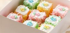 Sandra Lee Petite Fours Recipe- White Cake Mix, Flavoring Extract, Vanilla Frosting, and Coconut.