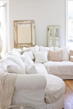 This is my dream sofa. Comfy. Soft. White. Big. Lots of pillows.