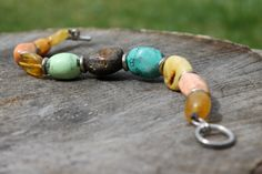 Raw stone bracelet in warm colors orange, yellow, teal, blue. Wonderful spring fashion jewelry. Made of natural gemstone big rough baltic amber chunks, turquoise, howlite, coral and metal beads. Fastened with fine toggle clasp. Bracelet size: about 17,5 cm -18,5 cm (6.7-7.3) wrist size  Back to the shop: DreamsFactory.etsy.com