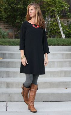 little black dress dressed down with boots and tights