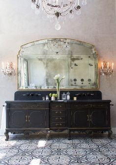 Queen Anne style mirror by Platner & Co. with antiqued, beveled glass and inset glass rosettes.