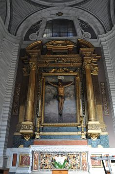 San Carlo al Corso, Rome.  Chapel of the Crucifix.  The impressive gilded wooden altar dates from the late 16th century, it was salvaged from the oratory of the Blessed Sacrament at Perugia.  The crucifix is by Cavallini and is placed over a landscape painting as was common at the time.
