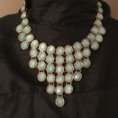 FINAL PRICE !! Statement Necklace NWT  Beautiful 48 blue tone stones in a vee drop necklace. Set in gold tone chain. Sparkle they do!!!!!   Would look stunning with any color dress or top. Or on a plunging neckline to lay on your skin. They sparkle and catch the light from any angle !!!! m. haskell Jewelry Necklaces