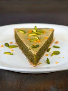 Pistachio and Almond Tart with Orange and Cardamom    Source: adapted from Casa Moro, by Sam and Sam Clark  Note: Since shelling your own pistachios is a real pain (literally!), try to find them pre-shelled - Indian, Turkish, Persian and Middle Eastern shops (or shops that sell things imported from these countries) are good places to look. To blanch pistachios (and almonds, for that matter), drop them in boiling water for a couple of minutes, then drain. The skins should peel off easily. If t...