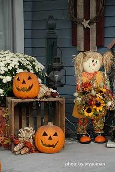 Autumn porch decor. Note: a good substitute for a bale of hay is an old wooden crate. Other items would be pumpkins, fall garland, corn and/or corn stalks, mums and an old lantern.