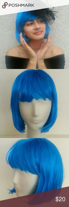 Blue Bob Wig Vibrant blue color that would definitely make a statement. Bangs that come to your brows.  Synthetic hair.  Great condition! Try Me Accessories Hair Accessories