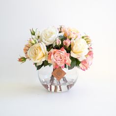 Classic beauty. These new garden roses are the queens of the real touch rose world...amazingly life like and set into a large fishbowl with realistic water resin.