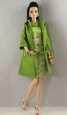 This listing is for a two piece coat and dress ensemble. The coat is A line with three quarter sleeves, flap pockets and collar. It is cut from green silk