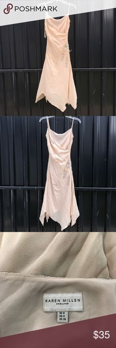 Karen Millen Nude Silk Embellished Rhinestones Very beautiful and elegant. This dress truly is red carpet worthy. It does have a few flaws- one is that it's missing a few beads from the strap, visible in picture. Also, it has been stored with the rest of the inventory, so it needs to be taken to the cleaners. I don't want to steam it before I ship because  I may stain it or mess up the silk. This dress has never been worn but it doesn't have the tags anymore. It was a customer return. The…